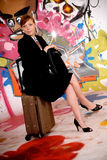 Woman commuter graffiti wall Stock Photo
