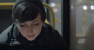 Woman commuter with mobile in the bus stock footage