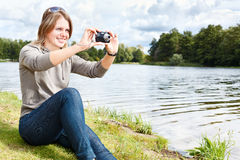 Woman with compact camera Royalty Free Stock Image