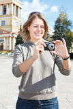 Woman with compact camera Stock Photography