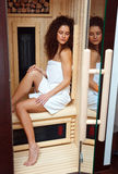 Woman in compact sauna Stock Photography