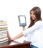 Woman compare books and new wireless reading digital ebook devic Stock Photography