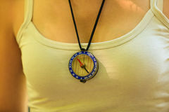 Woman with compass pendant. Royalty Free Stock Photography