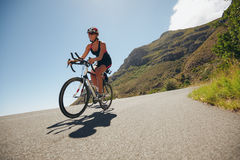 Woman competing in the cycling leg of a triathlon Royalty Free Stock Photography