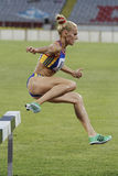 Woman competitor at 3000m steeplechase Royalty Free Stock Photos