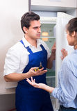 Woman complaining to handyman on problems Stock Image