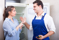 Woman complaining to handyman on problems Royalty Free Stock Image