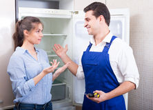 Woman complaining to handyman Royalty Free Stock Images