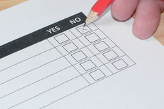 Woman completing customer survey form Royalty Free Stock Image