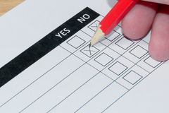 Woman completing customer survey form Royalty Free Stock Photography