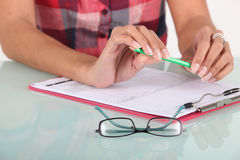 Woman completing a form Stock Photos