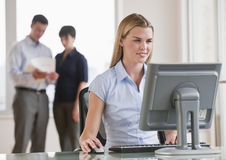 Woman on Computer Royalty Free Stock Images