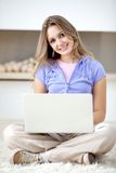 Woman with a computer Stock Image