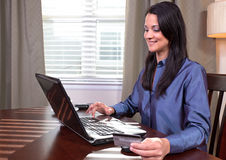 Woman on a computer Stock Images
