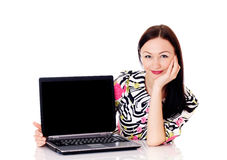 Woman with a computer. Beautiful woman presenting computer Royalty Free Stock Images