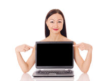 Woman with a computer. Beautiful woman presenting computer, isolated on white Royalty Free Stock Images