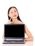 Woman with a computer. Beautiful woman presenting computer, isolated on white Stock Photography