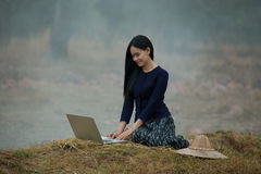 Woman computer on the countryside. Asian woman working with computer on the countryside Stock Photos