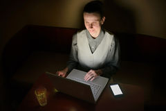 Woman at Computer in the Dark Stock Photography