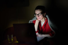 Woman at Computer in the Dark Royalty Free Stock Photos