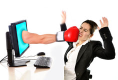 Woman with computer hit by boxing glove social media cyber mobbing. Business woman with computer hit by boxing glove in social media cyber mobbing and bullying royalty free stock photography