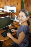 Woman at computer at home stock photos