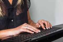 Woman with computer keyboard Stock Photo
