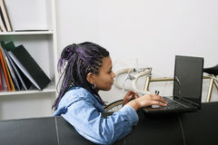 Woman with computer laptop. Female young with the computer laptop at home celebrating the success Stock Images