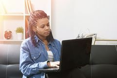 Woman with computer laptop. Female young with the computer laptop at home celebrating the success Royalty Free Stock Photography