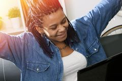 Woman with computer laptop. Female young with the computer laptop at home celebrating the success Royalty Free Stock Image