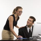 Woman at computer with man Royalty Free Stock Photography