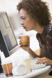Woman by computer with many cups of empty coffee Stock Images