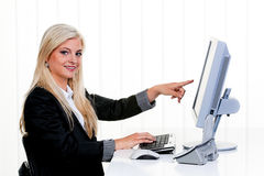 Woman with computer in office stock photo