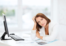 Woman with computer, papers and calculator Stock Photos