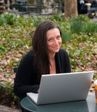 Woman With a Computer in a Park Stock Image