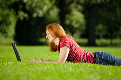 Woman with computer in a park Royalty Free Stock Image