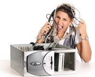 Woman computer problems. Young angry woman having problems with computer and phoning helpline Royalty Free Stock Photo