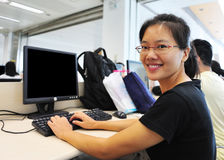 Woman in computer room Royalty Free Stock Image