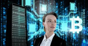 Woman with computer server and bitcoin technology information interface. Digital composite of Woman with computer server and bitcoin technology information stock photography