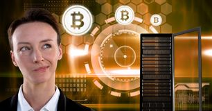 Woman with computer server and bitcoin technology information interface. Digital composite of Woman with computer server and bitcoin technology information stock photo