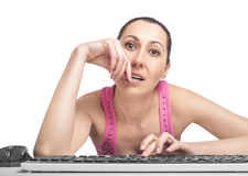 Woman on computer surfing internet Stock Photo