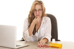 Woman computer taking pills Stock Photography