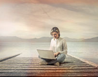 Woman with computer Royalty Free Stock Images