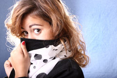 Woman concealing her face Stock Photography