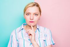 Woman concentrated face finger chin thinking. Need time to make decision. Come up with idea. Thinking about idea. Girl. Blonde thoughtful face expression close stock photo