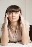 Woman concentrating closeup Stock Image