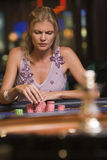 Woman concentrating at roulette table. In casino stock photography