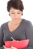 Woman concentrating writing notes Royalty Free Stock Photography