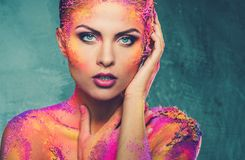 Woman with conceptual body art. Beautiful young woman with conceptual colourful body art Stock Photography
