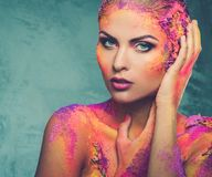 Woman with conceptual body art. Beautiful young woman with conceptual colourful body art Stock Photos